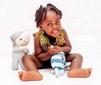 Little Girl with Stuffed Animals in Front of a White Background
