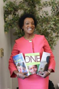 Dr. Gail Thompson holding copies of three of her books